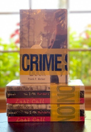 book trilogy wrapped in crime tape