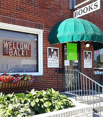 Store front with welcome back sign