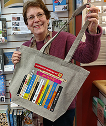Sally with an Independent Bookstore Day tote bag